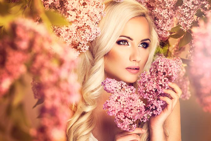 Blonde women surrounded by pink flowers